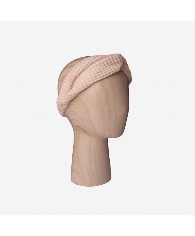 Bandeau cheveux en 100% coton nid d'abeille. Il maintient les cheveux pendant un soin ou son maquillage. Esthétique et pratique.